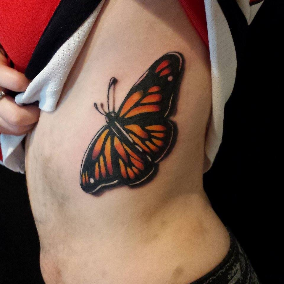 be9a31153 Color tattoo of monarch butterfly on ribs
